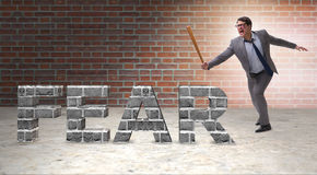 The angry man with baseball bat hitting fear word Stock Photography