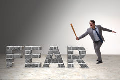The angry man with baseball bat hitting fear word Royalty Free Stock Image