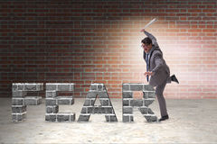 The angry man with baseball bat hitting fear word Stock Photo