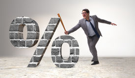 The angry man with baseball bat hitting percentage sign Stock Photography
