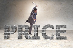 The angry man with baseball bat hitting price word Stock Photos
