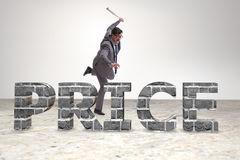 The angry man with baseball bat hitting price word Royalty Free Stock Photos