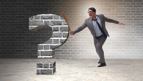 The angry man with baseball bat hitting question mark Royalty Free Stock Image