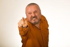 Angry man with a beard baring his teeth and snarling at the camera stock photo