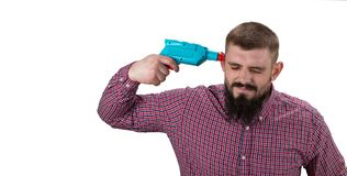 Angry man with beard in  shirt looks exhausted. Builder, plaster. Er, repairman, foreman on white background, copy space Tired labourer concept Royalty Free Stock Photography