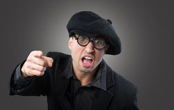 Angry man. In a beret pointing at camera Royalty Free Stock Photography