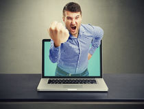 Angry man with big fist got out Royalty Free Stock Photo