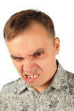 Angry man bites one's lip. On white Stock Image