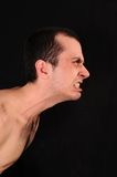 Angry man on black background Royalty Free Stock Images