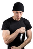 Angry man in black, threatening with knife isolated on white. Background stock photography