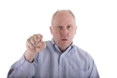 Angry Man in Blue Shirt Pointing at Camera Royalty Free Stock Image