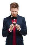 Angry man in blue suit with bow tie Stock Photo