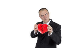 Angry man braking a heart Stock Photography