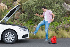 Angry man after a car breakdown. At the side of the road Royalty Free Stock Photo