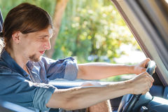 Angry man in car screaming while driving Royalty Free Stock Photos