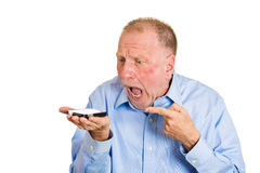 Angry man on cell phone Stock Photo