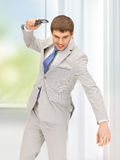 Angry man with cell phone. Picture of angry man with cell phone Royalty Free Stock Photography