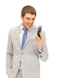 Angry man with cell phone. Picture of angry man with cell phone Royalty Free Stock Images