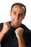 Angry man with clenched fists. Portrait of angry man grimacing with raised fists, white background Stock Photos