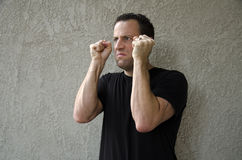 Angry man with clenched fists. Royalty Free Stock Images