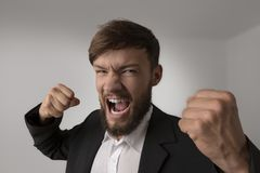 Angry man with clenched fists. Studio Shot Royalty Free Stock Images
