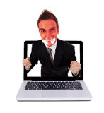 Angry man coming out from laptop Stock Photography