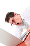Angry man with computer. Angry man using computer on white background Royalty Free Stock Photos