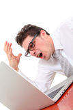 Angry man with computer. Angry man using computer on white background Royalty Free Stock Photo