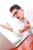 Angry man with computer. Angry man using computer on white background Royalty Free Stock Photography