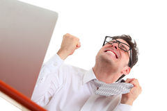 Angry man with computer. Angry man using computer on white background Stock Images
