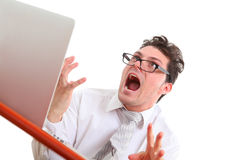 Angry man with computer. Angry man using computer on white background Stock Photo