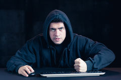 Angry man and computer Stock Images