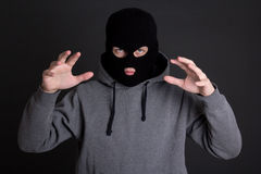 Angry man criminal, robber or burglar in black mask over grey Royalty Free Stock Photography