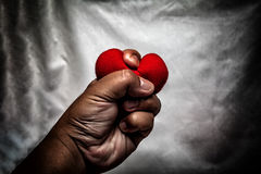 Angry man crushing red heart in hand., unrequited love., love co Royalty Free Stock Photography
