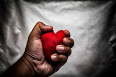 angry man crushing red heart in hand., unrequited love., love co Stock Photos