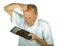 Angry man destroying his tablet computer Stock Photos