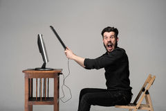 Angry man is destroying a keyboard Royalty Free Stock Image