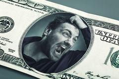 Angry man in the dollar banknote Royalty Free Stock Photography