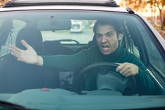 Angry man driver pissed off by drivers in front of him and gestu Royalty Free Stock Image