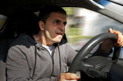 Angry man drives a vehicle. Without seat belt Stock Photo