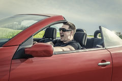 Angry man driving a car. Royalty Free Stock Image