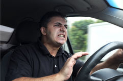 Angry man driving a vehicle. Without seat belt Stock Photos
