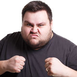 Angry man fighting with clenched fists, isolated Royalty Free Stock Photography
