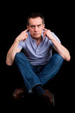 Angry Man Fingers in Ears Not Listening Cross Legged Royalty Free Stock Images