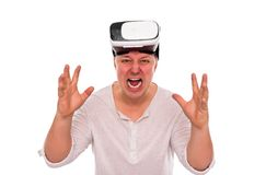 Angry man with glasses or a helmet of virtual reality on his head on a white. Angry man with glasses or a helmet of virtual reality on his head on a white Royalty Free Stock Image