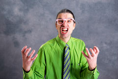 Angry man in green shirt pink glasses and necktie Royalty Free Stock Photos