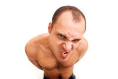 Angry man with hairy chest. Strong muscular angry man with hairy chest isolated on white Royalty Free Stock Images
