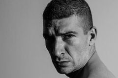 Angry man. Half profile portrait Stock Photos