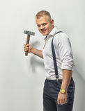 Angry man. With hammer on white stock photo