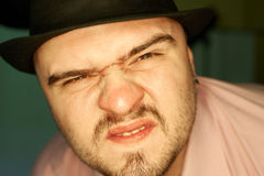 Angry man in hat. Stock Images